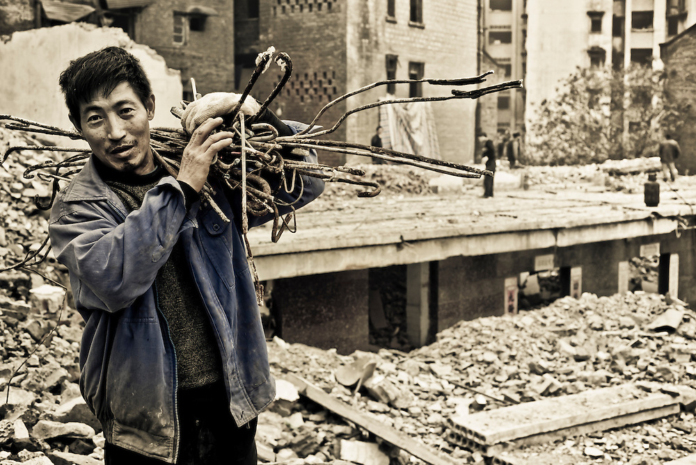 CHONGQING, CHINA - DEC 29, 2010: rebars and other materials are salvaged from demolished areas to be reused or sold.
