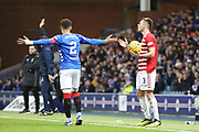 Rangers defender James Tavernier (2) and Hamilton Accademical defender Scott McMann (3) appeal for a decision durring the Ladbrokes Scottish Premiership match between Rangers and Hamilton Academical FC at Ibrox, Glasgow, Scotland on 16 December 2018.