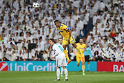 ALEX SANDRO of Juventus heads the ball under pressure from LUKA MODRIC of Real Madrid during the UEFA Champions League, quarter final, 2nd leg football match between Real Madrid CF and Juventus FC on April 11, 2018 at Santiago Bernabeu stadium in Madrid, Spain - Photo Manuel Blondeau / AOP Press / ProSportsImages / DPPI