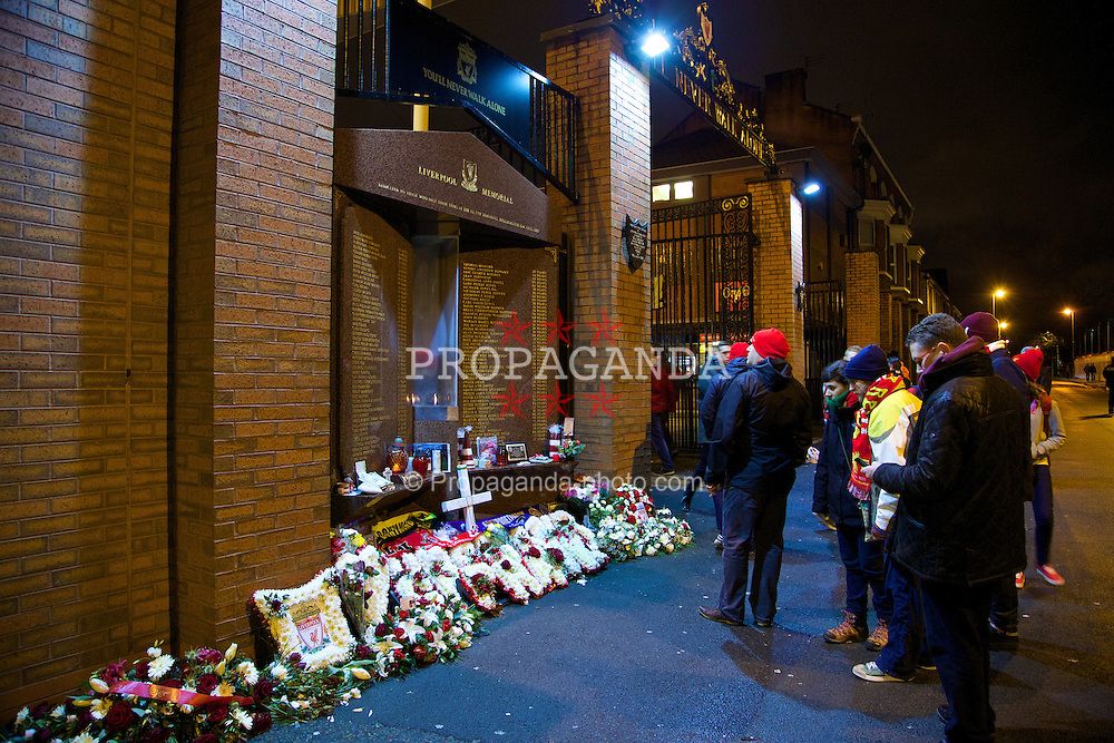 LIVERPOOL, ENGLAND - Tuesday, January 28, 2014: Liverpool supporters pay their respects at the Hillsborough Memorial before the 222nd Merseyside Derby Premiership match between Liverpool and Everton at Anfield. (Pic by David Rawcliffe/Propaganda)