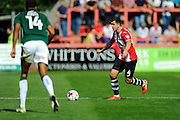 Lloyd James (4) of Exeter City during the EFL Sky Bet League 2 match between Exeter City and Plymouth Argyle at St James' Park, Exeter, England on 17 September 2016. Photo by Graham Hunt.