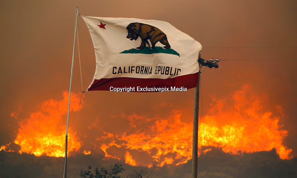 June 20, 2016 - Duarte, California, U.S. - The California state flag flies next to a home on Highway 94 south Potrero on Monday as huge flames roar behind it.<br /> &copy;Exclusivepix Media