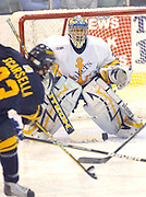 Canisius Griffins Vince Scarsella (left) fires a shot at Lake Superiior State University goaltender Brian Mahoney-Wilson during third period action of the Lakers/Griffins Saturday night game at Taffy Abel Arena.