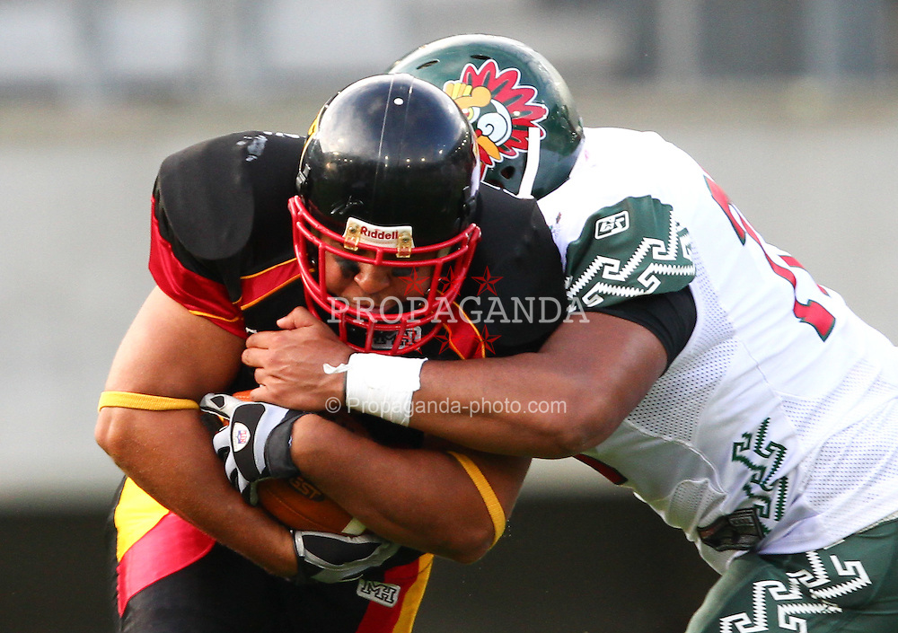 08.07.2011, Tivoli Stadion, Innsbruck, AUT, American Football WM 2011, Group A, Germany (GER) vs Mexico (MEX), im Bild Uresty Miguel angel (Mexico, #78, INT) tries to stop Jerome Morris (Germany, #31, RB)  // during the American Football World Championship 2011 Group A game, Germany vs Mexico, at Tivoli Stadion, Innsbruck, 2011-07-08, EXPA Pictures © 2011, PhotoCredit: EXPA/ T. Haumer