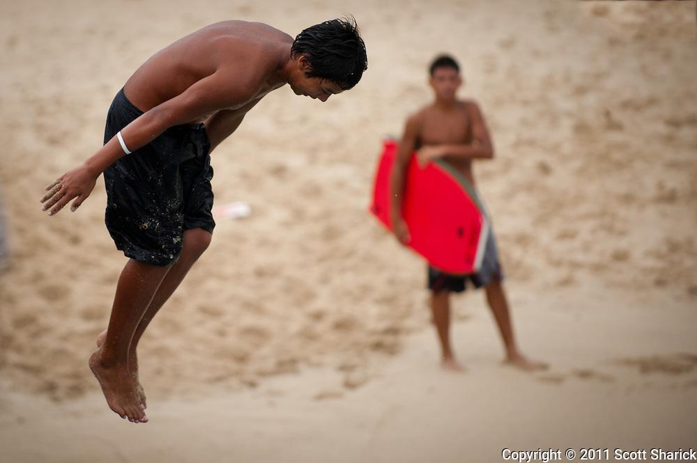 Water fun at the Kapahulu Groin in Waikiki, Hawaii.