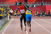 Braima Suncar Dabo (Guinnea-Bissau) helps Jonathan Busby (Aruba) towards the finish line in the 5000 Metres Men - Round 1, Heat 1, during the 2019 IAAF World Athletics Championships at Khalifa International Stadium, Doha, Qatar on 27 September 2019.