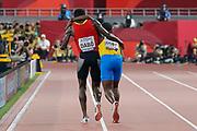 Braima Suncar Dabo (Guinnea-Bissau) helps Jonathan Busby (Aruba) towards the finish line in the 5000 Metres Men - Round 1, Heat 1, during the 2019 IAAF World Athletics Championships at Khalifa International Stadium, Doha, Qatar on 27 September 2019.
