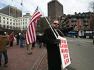 Boston, MA 01/19/2013.Steve Paulin of Grafton, MA waves at passing vehicles during a protest against proposed gun control legislation on Saturday at the Massachusetts State House, one of many protests held across the US..Alex Jones / www.alexjonesphoto.com