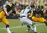 October 6 2013: Iowa Hawkeyes linebacker Christian Kirksey (20) eyes Michigan State Spartans returner Macgarrett Kings Jr. (3) as Iowa Hawkeyes long snapper Casey Kreiter (61) tries to get a hand on him during the first quarter of the NCAA football game between the Michigan State Spartans and the Iowa Hawkeyes at Kinnick Stadium in Iowa City, Iowa on October 6, 2013. Michigan State defeated Iowa 26-14.