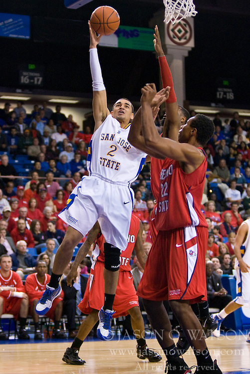 February 27, 2010; San Jose, CA, USA;  San Jose State Spartans guard Adrian Oliver (2) shoots over Fresno State Bulldogs center Greg Smith (22) during the first half at The Event Center.  San Jose State defeated Fresno State 72-45.