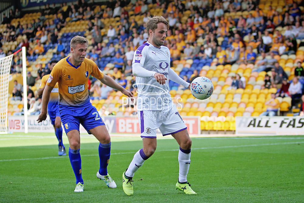 Luton Town midfielder Andrew Shinnie (11) controls the ball during the EFL Sky Bet League 2 match between Mansfield Town and Luton Town at the One Call Stadium, Mansfield, England on 26 August 2017. Photo by Nigel Cole.