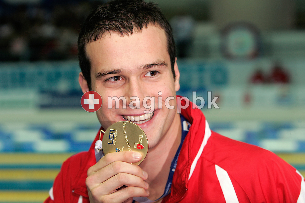 Markus ROGAN of Austria shows his gold medal after winning and setting a new world record in the final of the men's 200m Backstroke, during the European Swimming Short Course Championships on December 8, 2005, in Trieste, Italy. (Photo by Patrick B. Kraemer/MAGICPBK)