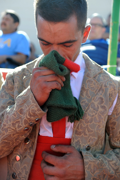 BEA AHBECK/NEWS-SENTINEL<br /> Grupo Forcados Amadores Luso-Americanos' Ricardo Teixeira prays at the beginning of the bloodless bullfight during the Our Lady of Fatima Portuguese Festival in Thornton Saturday, Oct. 14, 2017.