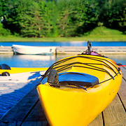 A yellow kayak on a dock in the Damariscotta River. Damariscotta, Maine