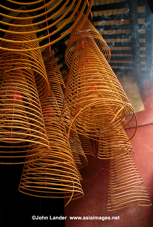 "Incense Coils at Kun Iam Temple - Incense spirals or incense coils are one type of incense. An incense coil is made entirely of incense. They are called incense spirals because they are shaped into a spiral instead of a straight stick shape and can burn for many hours. There are many forms of Chinese incense and its use and formulation theory is strongly tied to Traditional Chinese medicine and are still referred today as ""fragrant medicines"". Use of incense has long been as much for healthy well-being as religious ceremonies."
