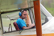 Wurtsboro, NY - A pilot in a 1965 Cessna Ector 305A airplane prepares to take offduring the grand reopening of Wurtsboro Airport on May 11, 2008.
