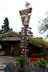 Visitor Information Center on Fourth Ave with milepost sign stating Anchorage Air Crossroads of the World, Anchorage, Alaska, United States of America
