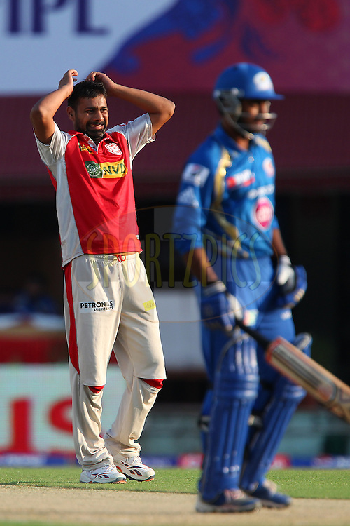 Praveen Kumar reacts after bowling during match 69 of the Pepsi Indian Premier League between The Kings XI Punjab and the Mumbai Indians held at the HPCA Stadium in Dharamsala, Himachal Pradesh, India on the on the 18th May 2013..Photo by Ron Gaunt-IPL-SPORTZPICS ..Use of this image is subject to the terms and conditions as outlined by the BCCI. These terms can be found by following this link:..http://www.sportzpics.co.za/image/I0000SoRagM2cIEc