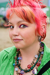 Young woman with dyed pink hair at the WOMAD (World of Music; Arts and Dance) Festival in reading; 2005,