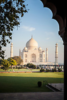 The Taj Mahal as seen from an angle off to the side through cusped archwayl, Agra, Uttar Pradesh,  India.
