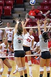 03 SEP 2008: Peggy Riessen stikes the ball towards Morgan Johnson and Amanda Tadia. The Redbirds huddle up before team introductions. The Northern Illinois University Huskies and the Illinois State Redbirds meet at Redbird Arena on the campus of Illinois State University in Normal Illinois.