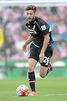 """Liverpool's Adam Lallana during the Barclays Premier League match at the Britannia Stadium, Stoke-on-Trent. PRESS ASSOCIATION Photo. Picture date: Sunday August 9, 2015. See PA story SOCCER Stoke. Photo credit should read: Martin Rickett/PA Wire. EDITORIAL USE ONLY. No use with unauthorised audio, video, data, fixture lists, club/league logos or """"live"""" services. Online in-match use limited to 45 images, no video emulation. No use in betting, games or single club/league/player publications."""