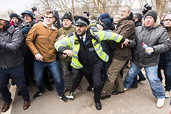 "© Licensed to London News Pictures . 18/03/2018 . London , UK . Police intervene as supporters and those opposed to the speech fight at Speakers Corner . Alt-right groups , including Generation Identity and the Football Lads Alliance , at Speakers' Corner in Hyde Park ahead of Tommy Robinson reading a speech by Generation Identity campaigner Martin Sellner . Along with Brittany Pettibone , Sellner was due to deliver the speech last week but the pair were arrested and detained by police when they arrived in the UK , forcing them to cancel an appearance at a UKIP "" Young Independence "" youth event , which in turn was reportedly cancelled amid security concerns . Photo credit: Joel Goodman/LNP"