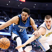 15 February 2017: Minnesota Timberwolves center Karl-Anthony Towns (32) vies for the loose ball with Denver Nuggets forward Nikola Jokic (15) during the Minnesota Timberwolves 112-99 victory over the Denver Nuggets, at the Pepsi Center, Denver, Colorado, USA.