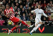 Real Madrid's Cristiano Ronaldo against Almeria's Chico during La Liga match, November 05, 2009.