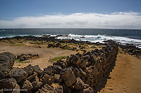 Rock wall ending at the ocean. South Point, Big Island Hawaii.