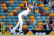 Stuart Broad follows through while bowling from the Vulture Street end on Day 1 of the 1st Test in the 2013-14 Ashes Cricket Series between Australia and England at the GABBA (Brisbane, Australia) from Thursday 21st November 2013<br /> <br /> Conditions of Use : NO AGENTS ~ This image is subject to copyright and use conditions stipulated by Cricket Australia.  This image is intended for Editorial use only (news or commentary, print or electronic) - Required Image Credit : &quot;Steven Hight - AURA Images&quot;