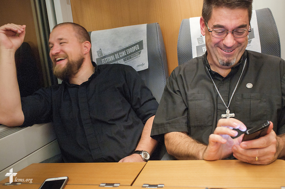 The Rev. Adam Lehman and the Rev. David Warner, both LCMS career missionaries to Spain, enjoy a lighter moment on a train to Sevilla from Madrid following a long Saturday, Nov. 5, 2016, in Spain. LCMS Communications/Erik M. Lunsford