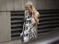© Licensed to London News Pictures. 25/07/2017. London, UK. CONNIE YATES makes a phonecall during a break in proceedings at The The Royal Courts of Justice in London . The parents of terminally ill Charlie Gard have returned to court in an attempt to take their terminally ill son home to die rather than ending his life in hospital. Yesterday a court ruled that Charlie, who suffers from a rare genetic condition known as mitochondrial DNA depletion syndrome, should not be taken to US for further treatment. Photo credit: Peter Macdiarmid/LNP