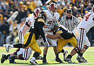 October 31, 2009: Indiana wide receiver Mitchell Evans (5) tries to spin  away from Iowa defensive tackle Karl Klug (95) during the first half of the Iowa Hawkeyes' 42-24 win over the Indiana Hoosiers at Kinnick Stadium in Iowa City, Iowa on October 31, 2009.