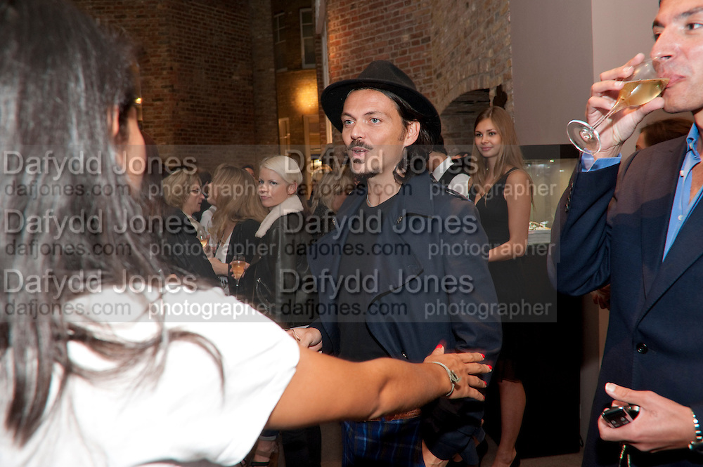 MATTHEW WILLIAMSON,  Vogue Fashion night out.- Alexandra Shulman and Paddy Byng are host a party  to celebrate the launch for FashionÕs Night Out At Asprey. Bond St and afterwards in the street. London. 8 September 2011. <br />  <br />  , -DO NOT ARCHIVE-© Copyright Photograph by Dafydd Jones. 248 Clapham Rd. London SW9 0PZ. Tel 0207 820 0771. www.dafjones.com.<br /> MATTHEW WILLIAMSON,  Vogue Fashion night out.- Alexandra Shulman and Paddy Byng are host a party  to celebrate the launch for Fashion's Night Out At Asprey. Bond St and afterwards in the street. London. 8 September 2011. <br />  <br />  , -DO NOT ARCHIVE-© Copyright Photograph by Dafydd Jones. 248 Clapham Rd. London SW9 0PZ. Tel 0207 820 0771. www.dafjones.com.