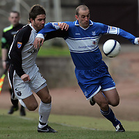 St Johnstone v Gretna..27.01.2007<br /> Paul Sheerin is challenged by Craig Barr<br /> <br /> Picture by Graeme Hart.<br /> Copyright Perthshire Picture Agency<br /> Tel: 01738 623350  Mobile: 07990 594431