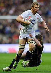England Flanker (#7) Chris Robshaw (Harlequins, capt) is tackled during the first half of the match - Photo mandatory by-line: Rogan Thomson/JMP - Tel: Mobile: 07966 386802 02/02/2013 - SPORT - RUGBY UNION - Twickenham Stadium - London. England v Scotland - 2013 RBS Six Nations Championship. The winner of this fixture is awarded the Calcutta Cup.