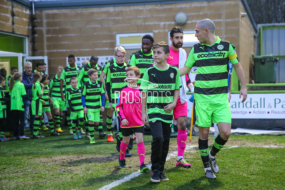 FGR ambassadors walk out with the team during the Vanarama National League match between Forest Green Rovers and Dover Athletic at the New Lawn, Forest Green, United Kingdom on 17 December 2016. Photo by Shane Healey.