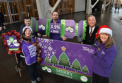 Pictured: Tom Waterson, Laura McDonald, Watty Gaffney, George Frame and Lillian Macer from UNISON with a giant Christmas card and cracker demanding fair pay for NHS workers.<br /> <br /> UNISON delivers 5000 'Fair Pay Now' cards to MSP's at the Scottish Parliament, demanding the Scottish Government 'pays up on NHS pay'.<br /> <br /> © Dave Johnston/ EEm
