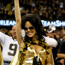 2009 November 30: A female fan cheers from the stands for the New Orleans Saints during a 38-17 win by the New Orleans Saints over the New England Patriots at the Louisiana Superdome in New Orleans, Louisiana.