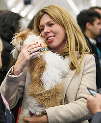 © Licensed to London News Pictures. 13/12/2019. London, UK. CARRIE SYMONDS, partner of British Prime Minster Boris Johnson, with her dog DILYN at the General Election count for the constituency of Uxbridge and South Ruislip. A general election was called for December 12th following a deadlock in Parliament over the UK's decision to leave the EU. Photo credit: Ben Cawthra/LNP