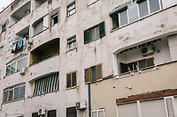 """NAPLES, ITALY - 2 FEBRUARY 2019:  The façade of a building in the Rione Luzzatti, the neighborhood in which Elena Ferrante's """"My Brilliant Friend"""" is set, is seen here in Naples, Italy, on February 2nd 2019.<br /> <br /> In December 2018, City Sightseeing - the world's largest sightseeing tour bus operator - inaugurated the """"Brilliant Naples"""" tour, inspired by the locations in """"Neapolitan Novels"""", a 4-part series by the Italian novelist Elena Ferrante. The series has sold over 10 million copies in 40 countries. The first book in the series has also been adapted into an HBO television series entitled, """"My Brilliant Friend."""""""