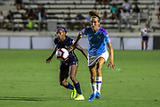 Manchester City midfielder Jill Scott (8) and North Carolina Courage forward Crystal Dunn (19) race to a loose ball during an International Champions Cup women's soccer game, Thurday, Aug. 15, 2019, in Cary, NC. The North Carolina Courage defeated Manchester City Women 2-1.  (Brian Villanueva/Image of Sport)