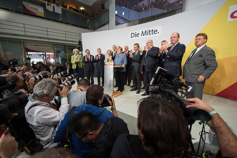 24 SEP 2017, BERLIN/GERMANY:<br /> Angela Merkel (M), CDU, Bundeskanzlerin, eingerahmt von Monika Gruetters, Armin Laschet, Thomas de Maiziere, Ursula von der Leyen, Jens Spahn, Volker Kauder, Karl-Josef Laumann, Guenther Oettinger, Peter Altmeier, Dr. Philipp Murmann, Elmar Brok, (v.L.n.R.), Wahlparty in der Wahlnacht, Bundestagswahl 2017, Konrad-Adenauer-Haus, CDU Bundesgeschaeftsstelle<br /> IMAGE: 20170924-01-0<br /> KEYWORDS: Election Party, Election Night