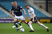 Eunan O'Kane of Leeds United (right) and George Saville of Millwall during the EFL Sky Bet Championship match between Millwall and Leeds United at The Den, London, England on 16 September 2017. Photo by Toyin Oshodi.