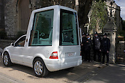 Pope Benedict XVI's Popemobile is transported to Lambeth Palace during the Pontif's papal tour of Britain 2010, the first visit by a pontiff since 1982. Two specially-adapted cars were brought over, modified from a Mercedes M-Class and each costing £75,000. SCV1 stands for Stato della Citta del Vaticano. Taxpayers footed the £10m bill for non-religious elements of the tour, which largely angered a nation still reeling from the financial crisis. Pope Benedict XVI is the head of the biggest Christian denomination in the world, some one billion Roman Catholics, or one in six people. In Britain there are about five million Catholics but only a quarter of Catholics regularly attend Sunday Mass and some churches have closed owing to spending cuts.