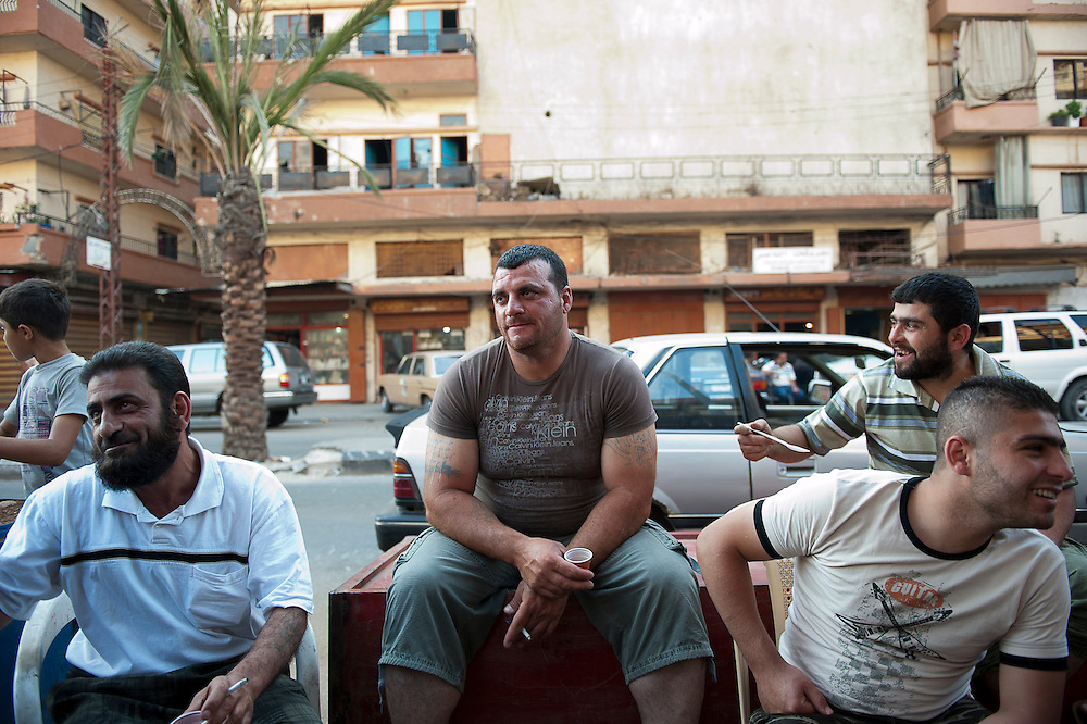 Sunni neighborhood Bab al-Tebbaneh Tripoli, these men say they fight and spent much of their salary of arms and ammunition, Lebanon, Tripoli