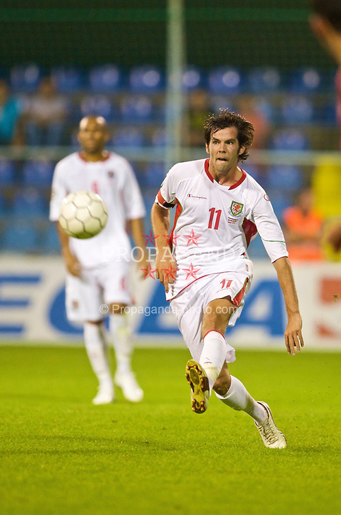 PODGORICA, MONTENEGRO - Wednesday, August 12, 2009: Wales' captain Joe Ledley in action against Montenegro during an international friendly match at the Gradski Stadion. (Photo by David Rawcliffe/Propaganda)