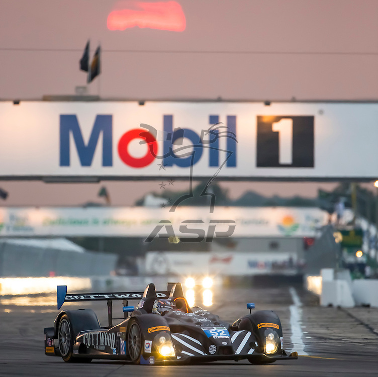 Sebring, FL - Mar 19, 2015:  The PR1 Mathiasen Motorsport ORECA FLM09 Chevrolet races through the turns at 12 Hours of Sebring at Sebring Raceway in Sebring, FL.
