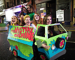 © Licensed to London News Pictures . 26/12/2018. Wigan, UK. Six women pay homage to Scooby Doo . Revellers in Wigan enjoy Boxing Day drinks and clubbing in Wigan Wallgate . In recent years a tradition has been established in which people go out wearing fancy-dress costumes on Boxing Day night . Photo credit: Joel Goodman/LNP